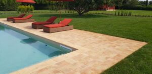 This traditional villa in rural Italy has been modernized with a large swimming pool in terracotta, color Rosato.